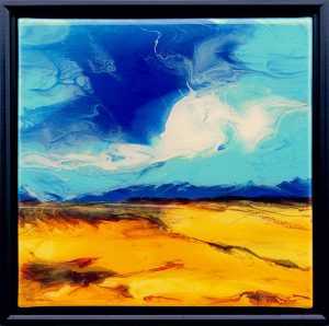 painting of clouds, mountains and dunes done with acrylic and mixed media with resin finish on canvas